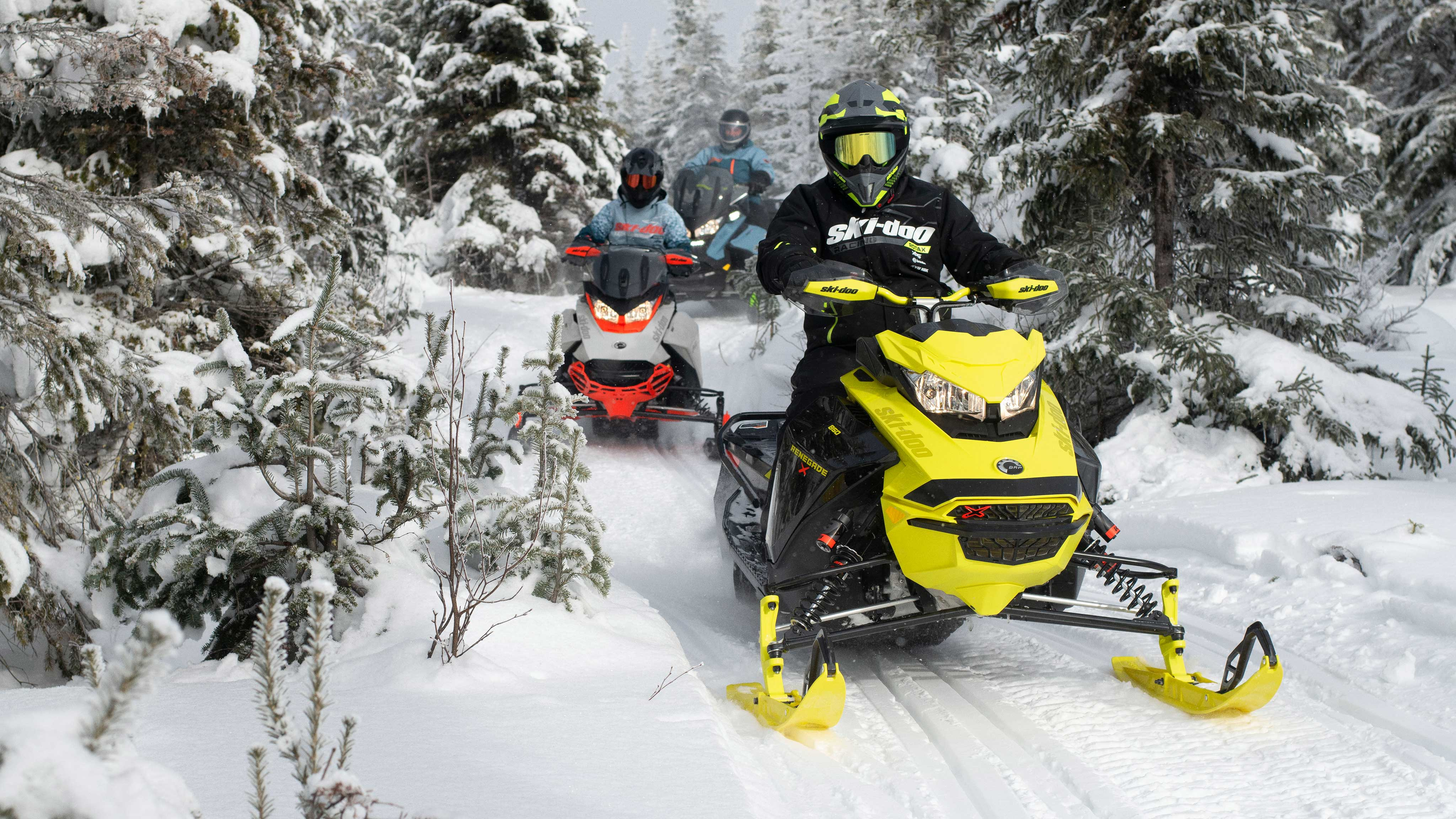 Group of riders driving the 2022 Ski-Doo lineup