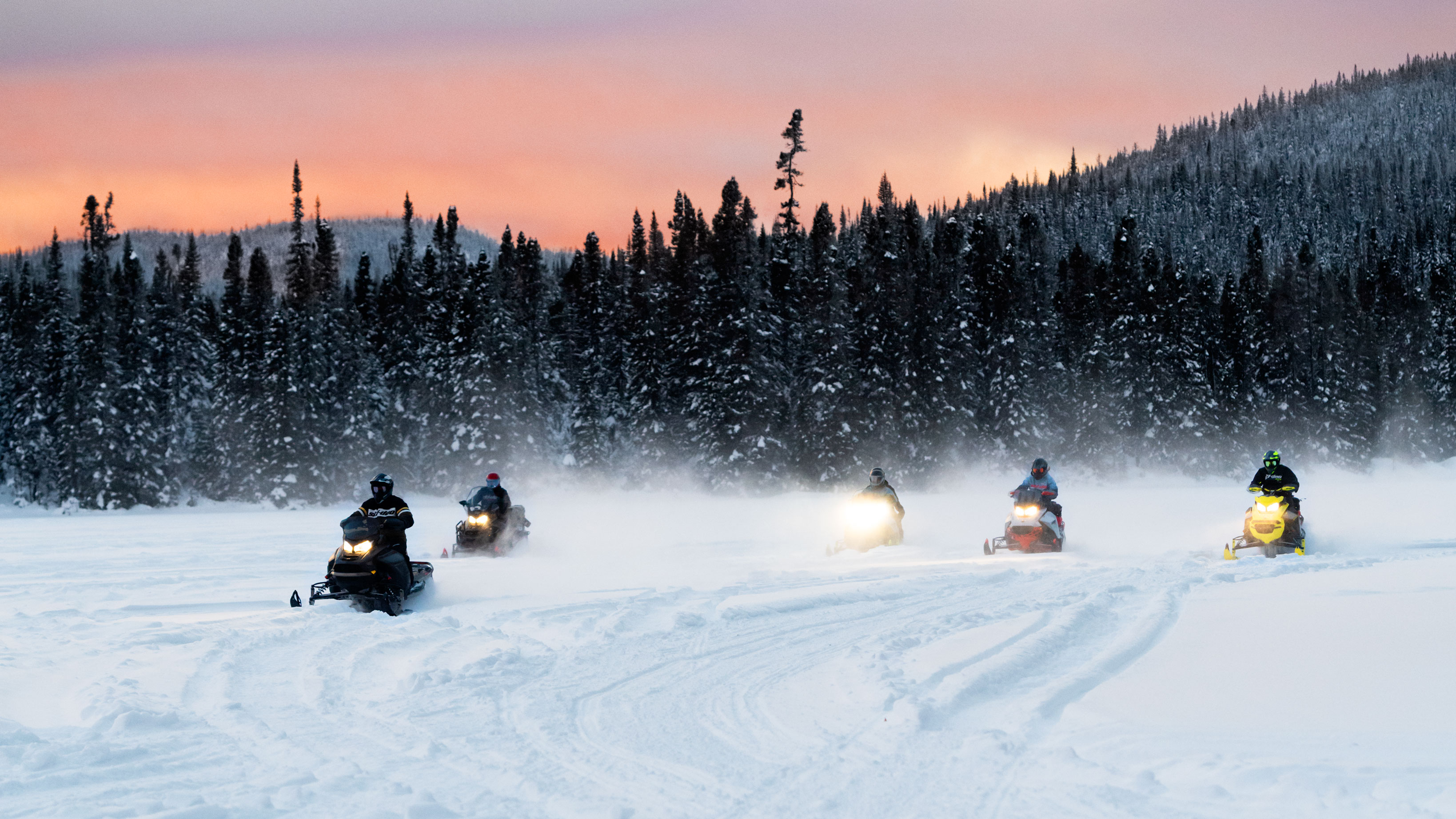 Ski-Doo Trail snowmobiles riding in group