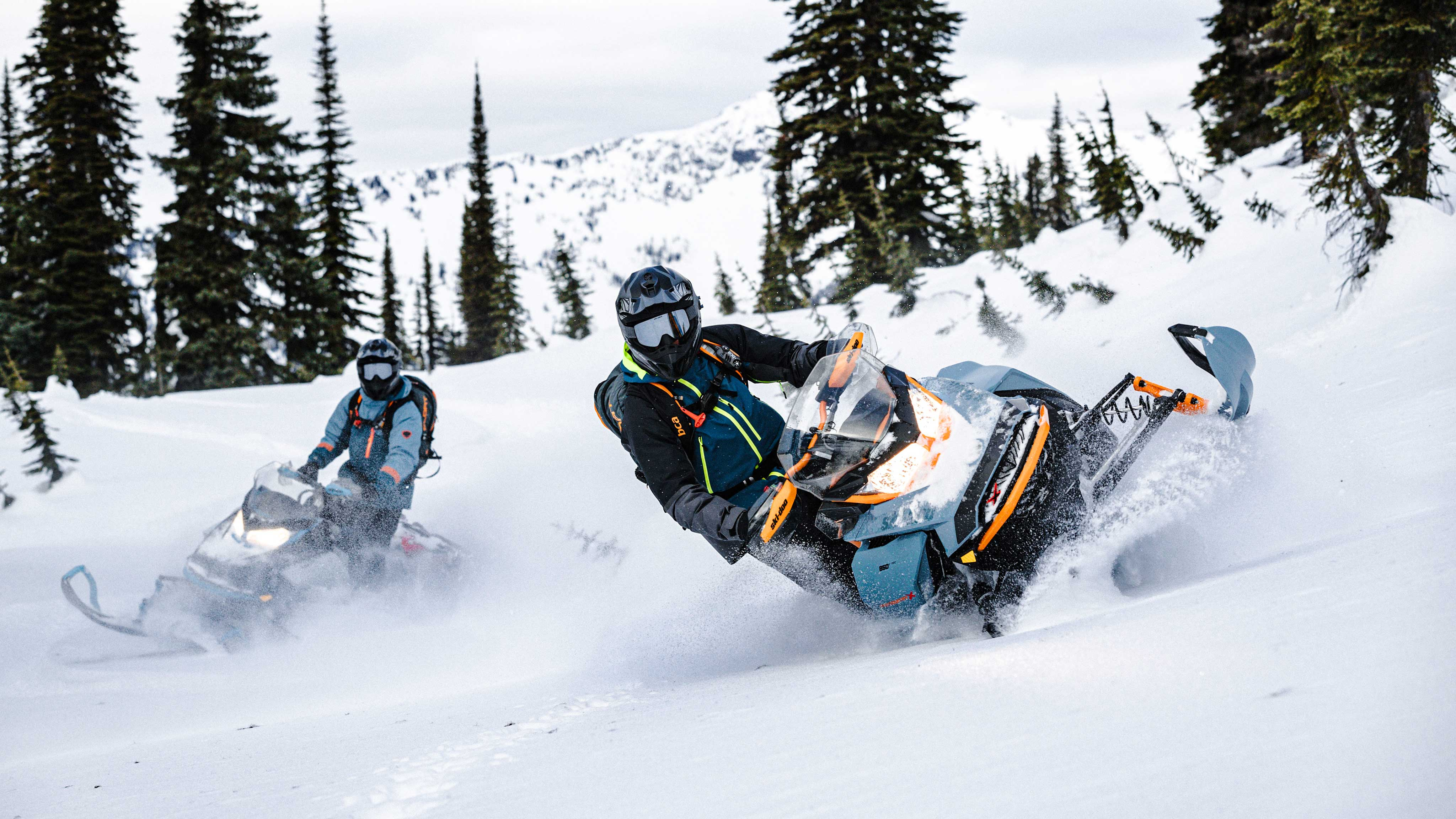 2 riders riding the new 2022 Ski-Doo Backcountry