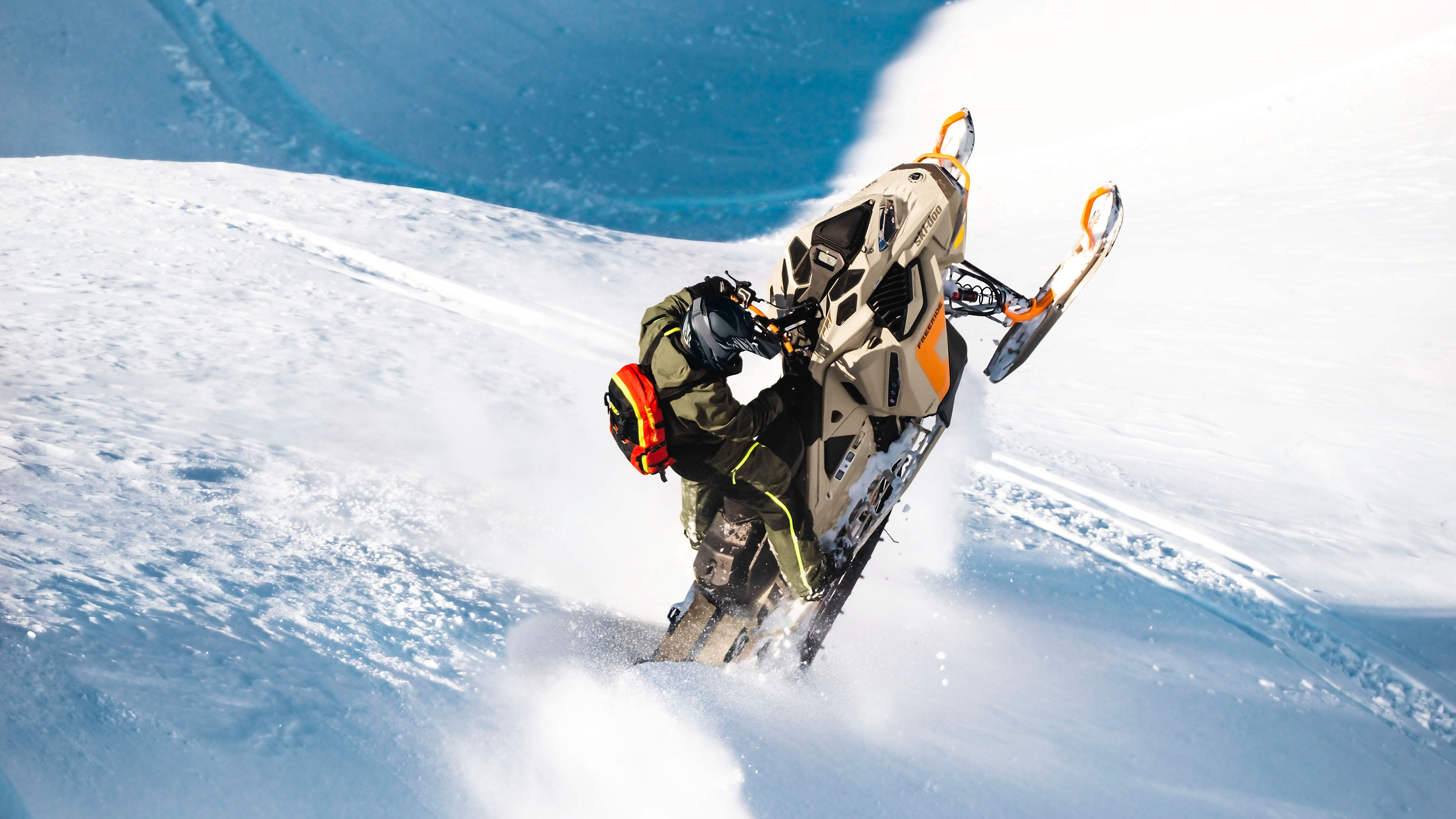 Man enjoying a snowmobile freeride session