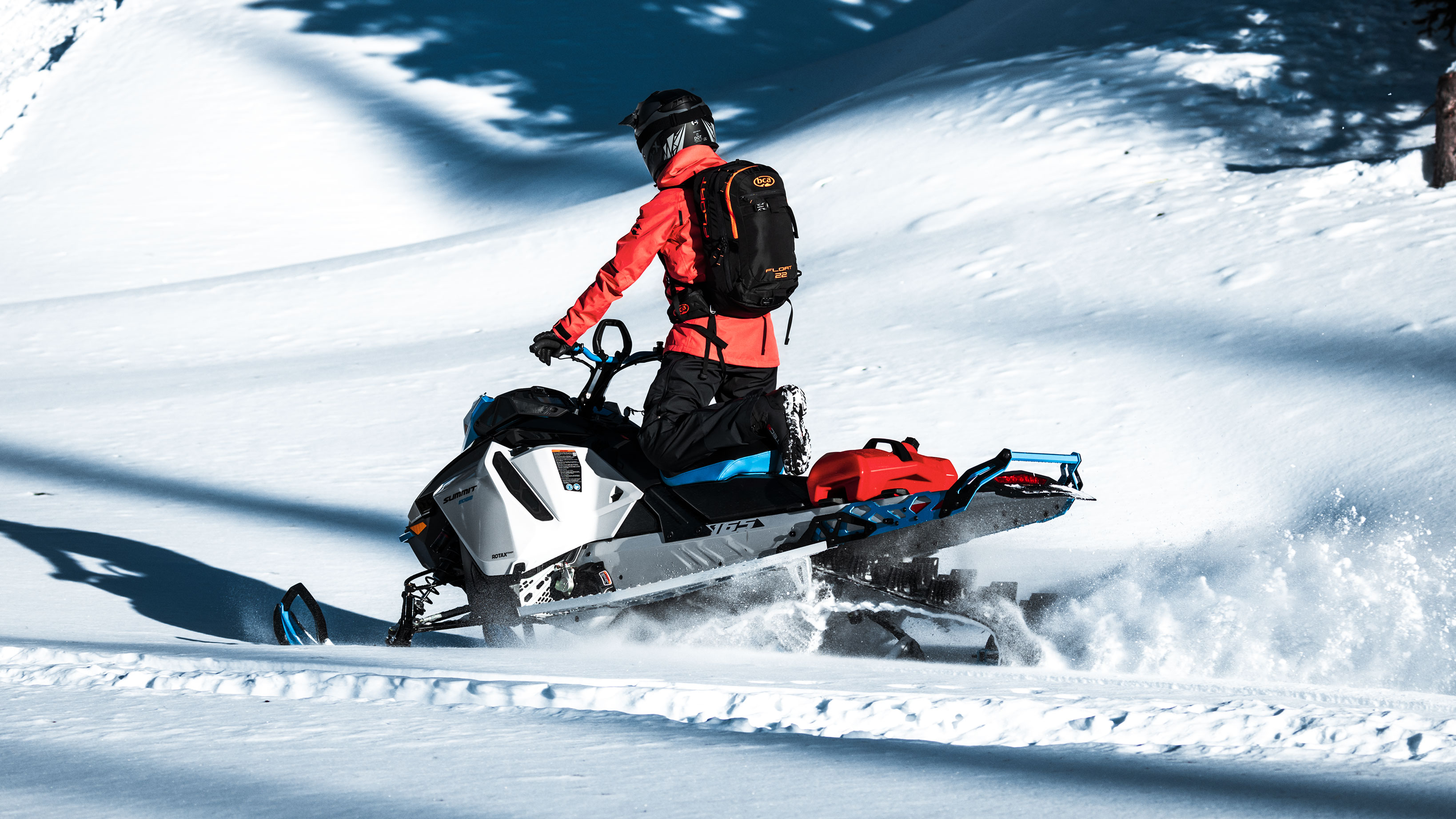 Man driving 2022 Ski-Doo Summit in a mountain ride
