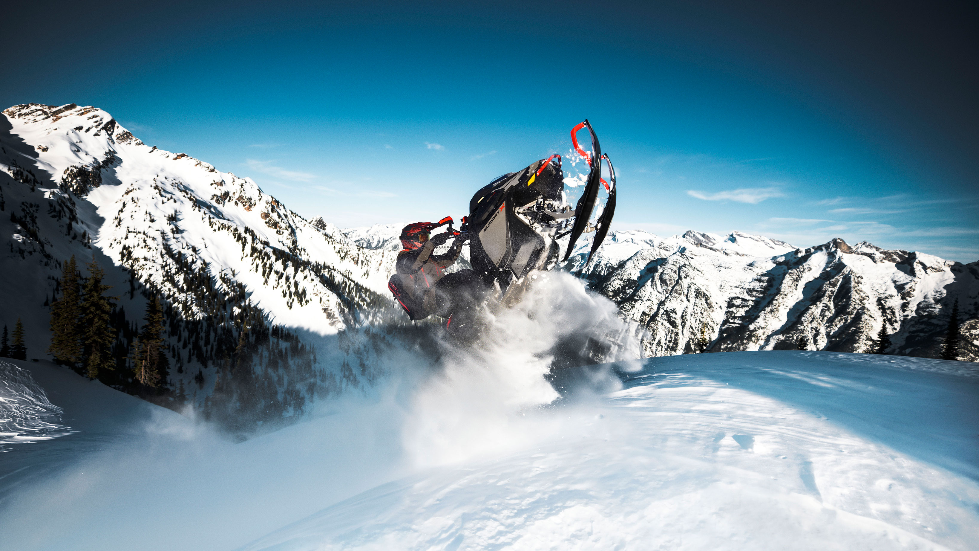 Ski-Doo Summit jumping in Deep-Snow