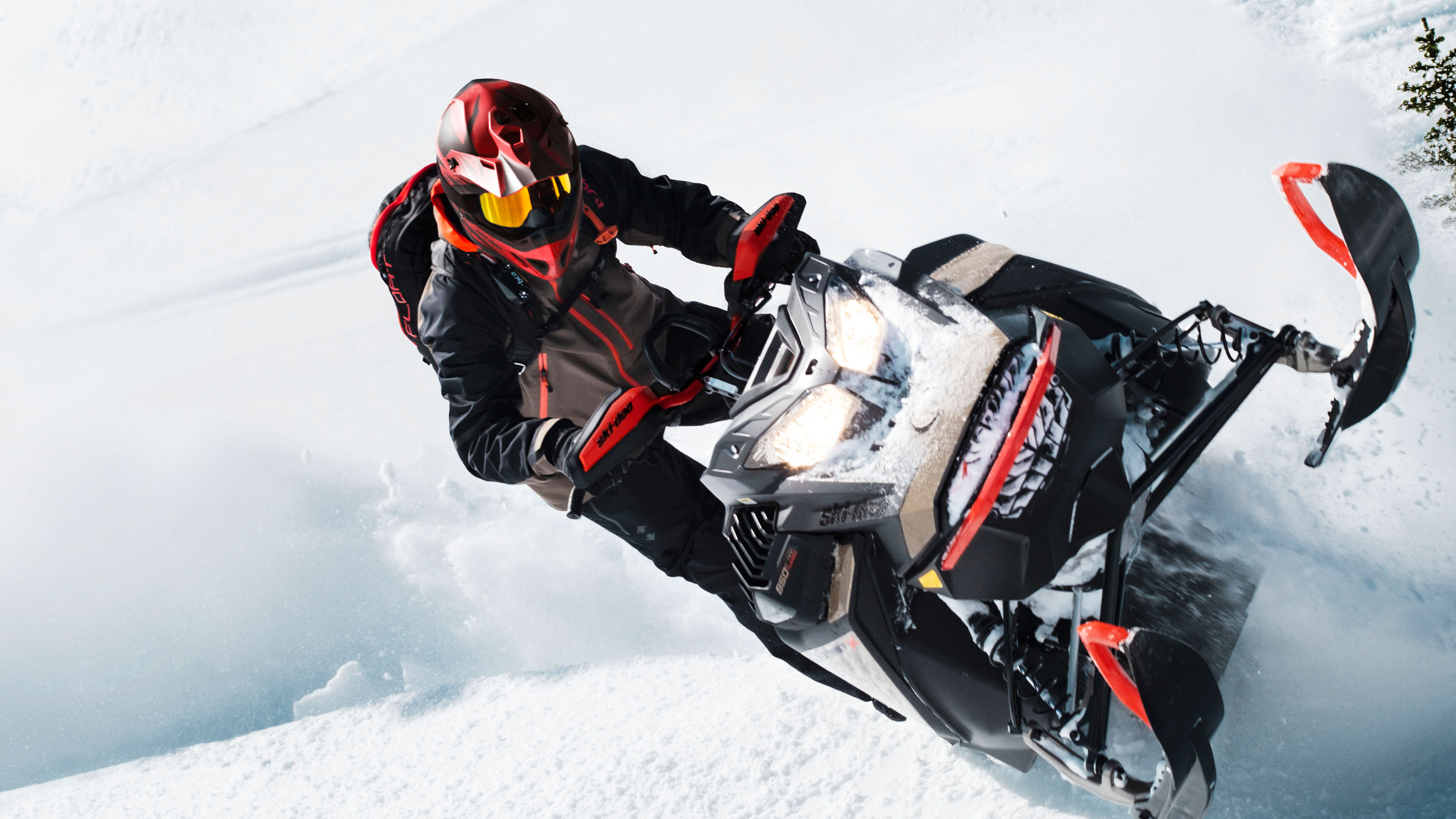 Man having big thrills in deep snow with his Ski-Doo Summit