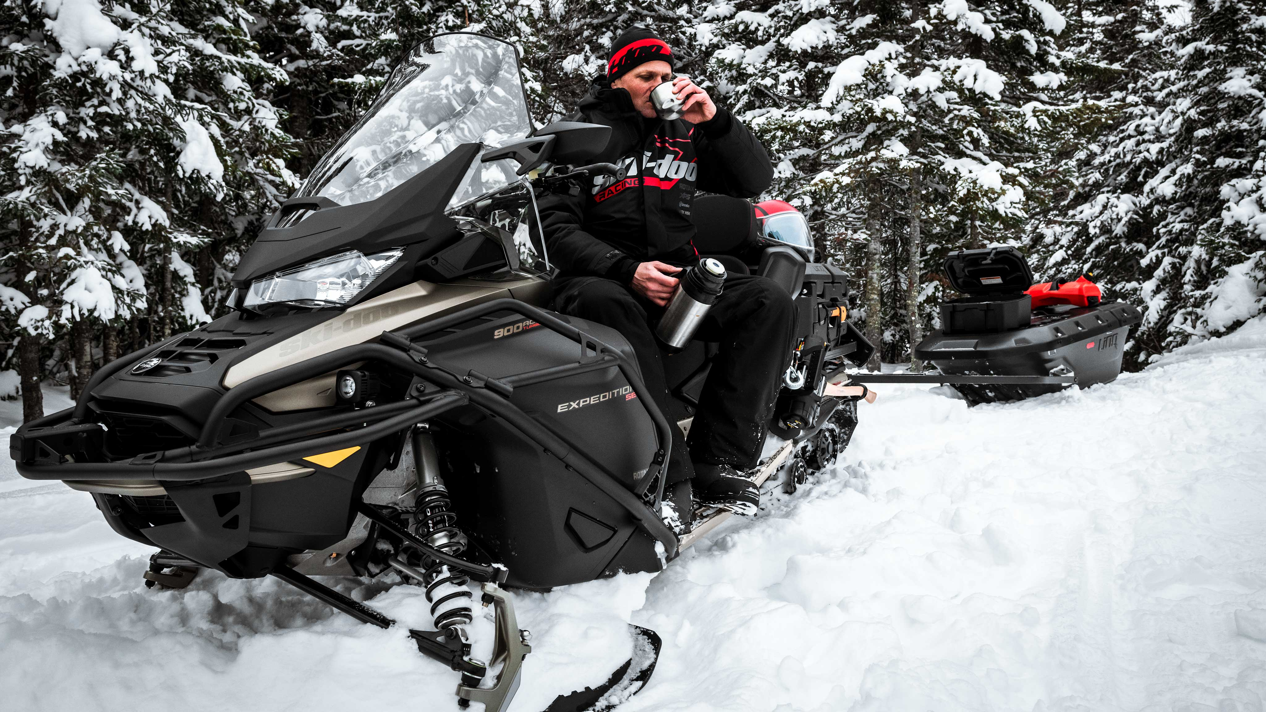 Man taking a coffee on his Ski-Doo Expedition