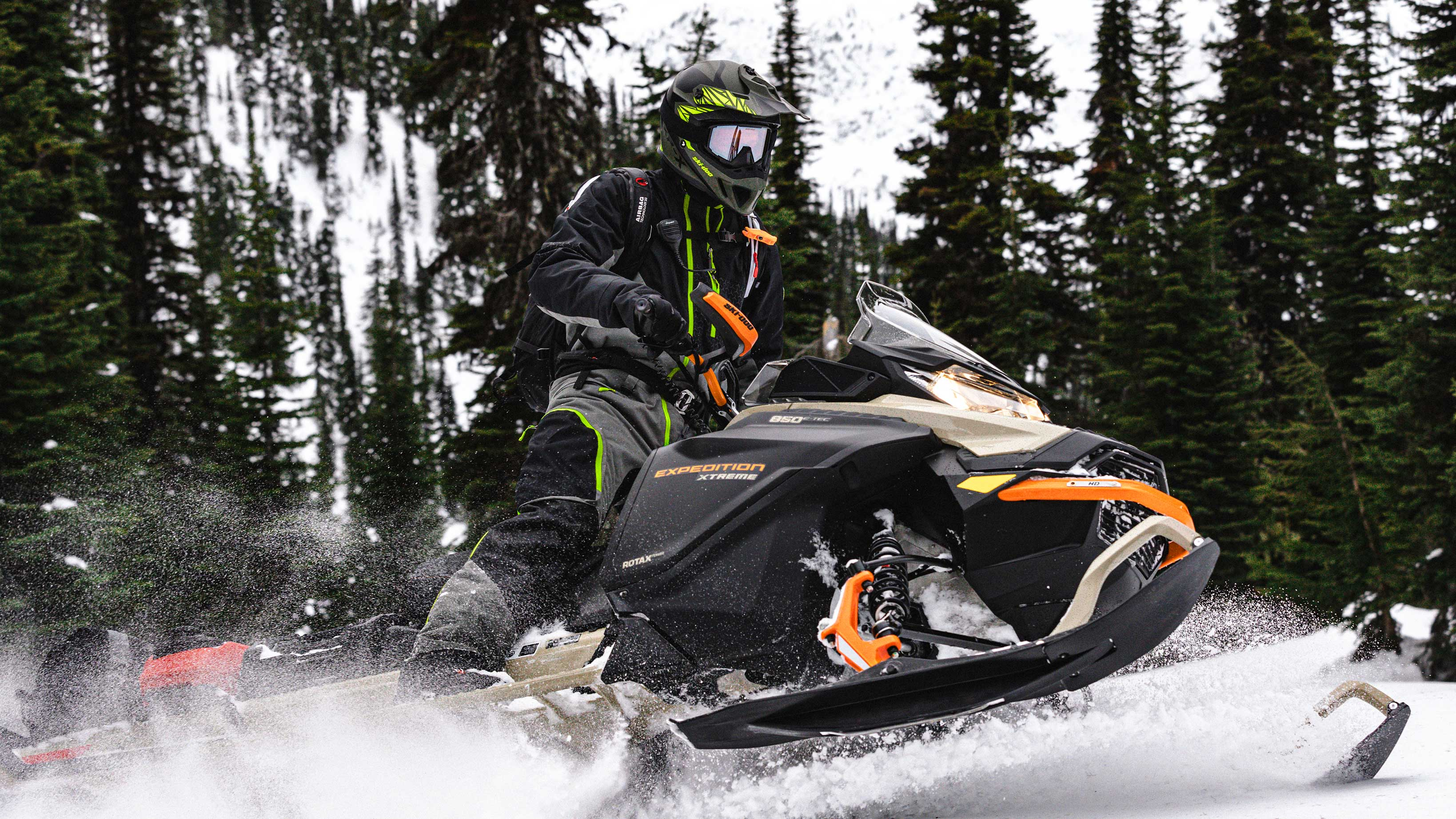 Man driving fast his Ski-Doo Expedition
