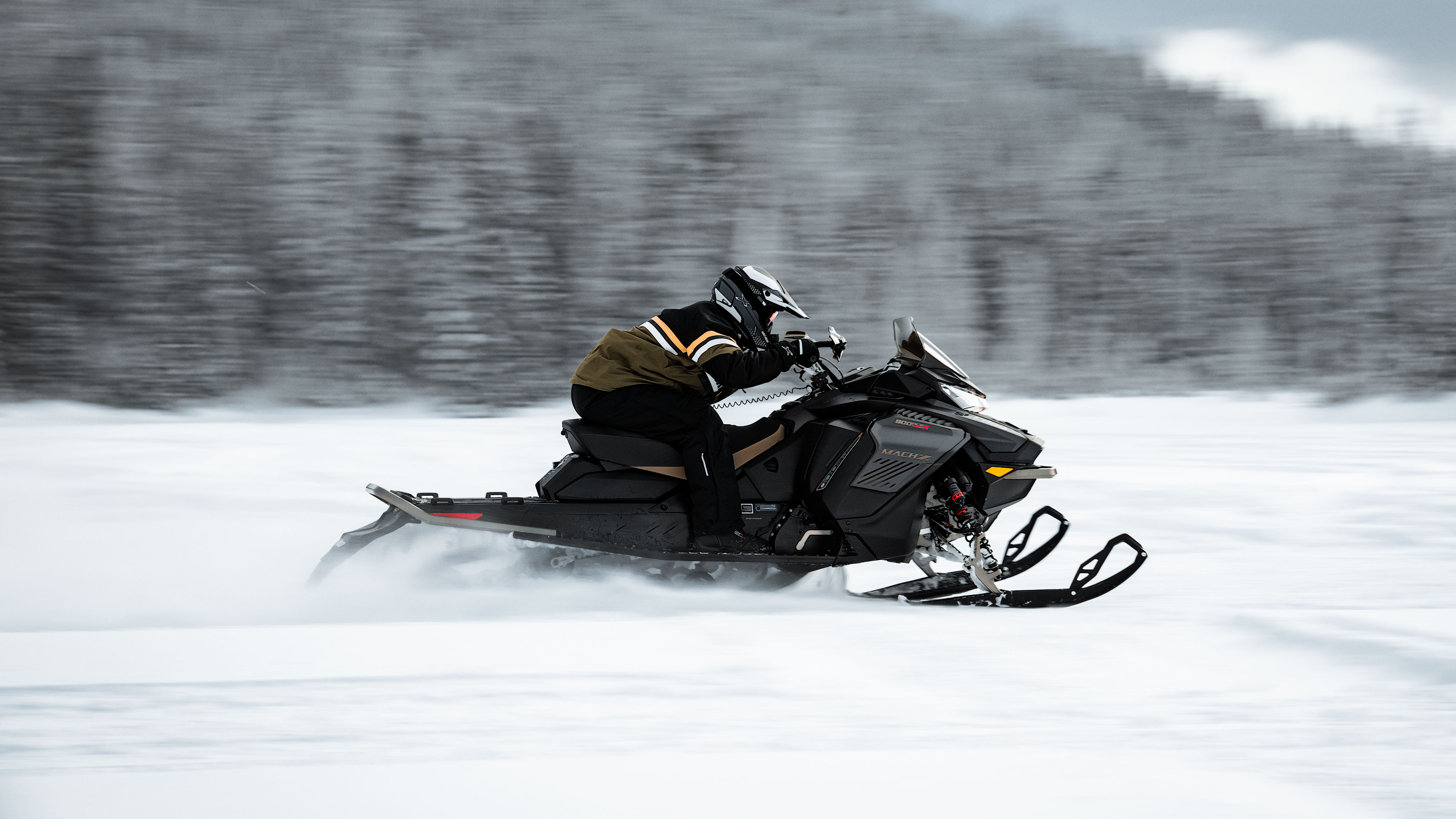 Man driving fast on the 2022 Ski-Doo Mach-Z