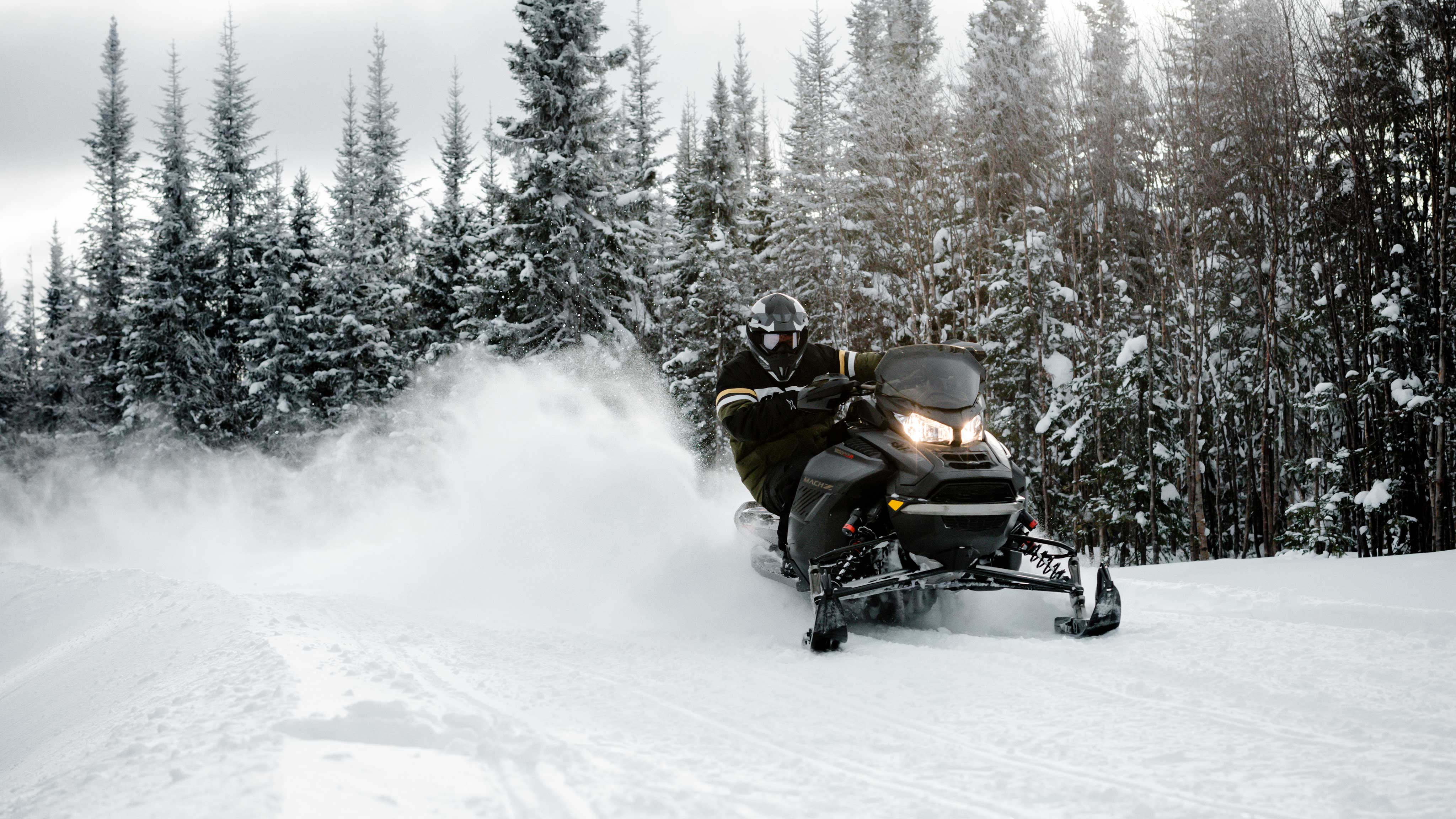 Pilot carving with his 2022 Ski-Doo Mach-Z