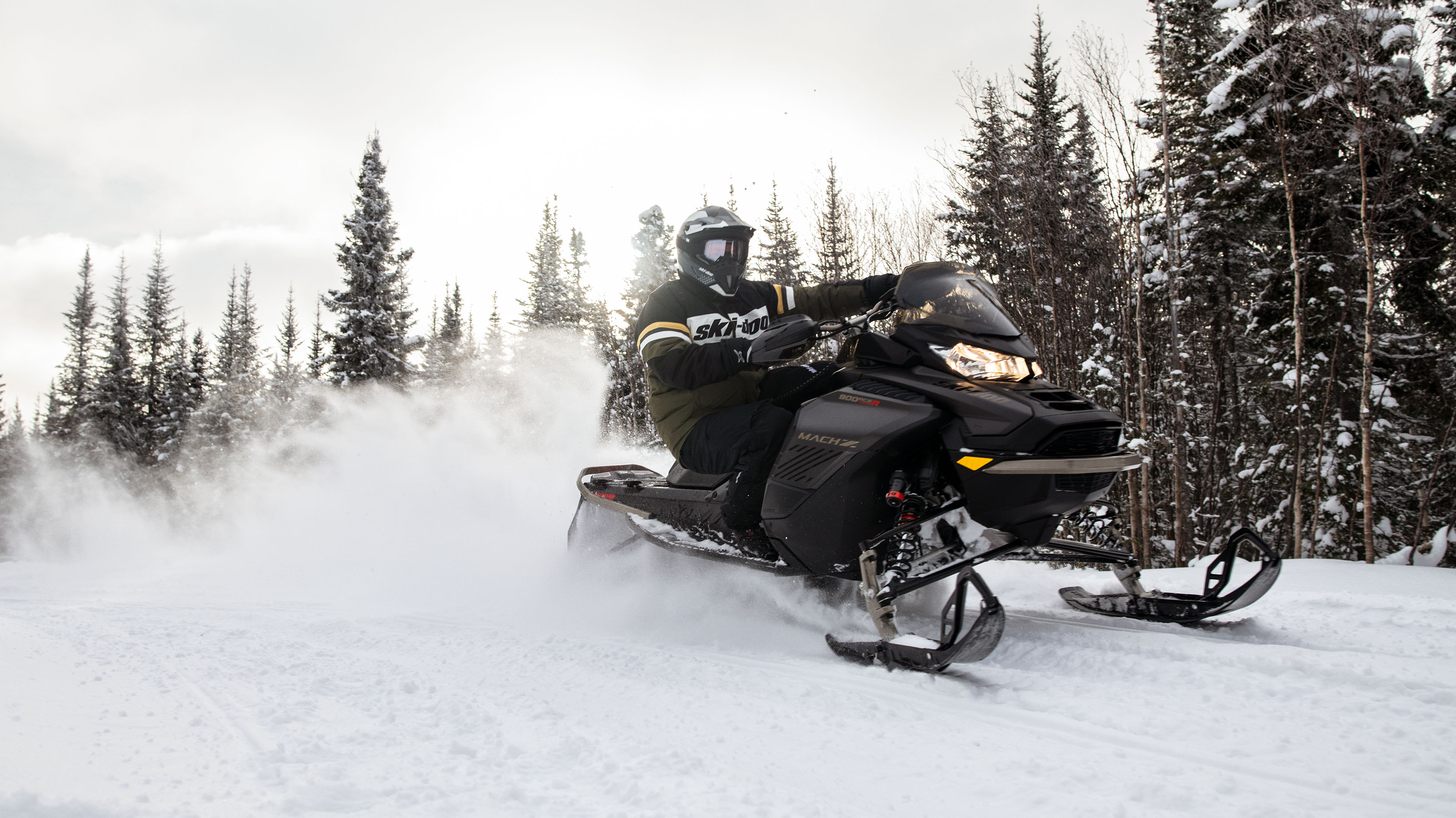 Man and his 2022 Ski-Doo Mach-Z on a trail
