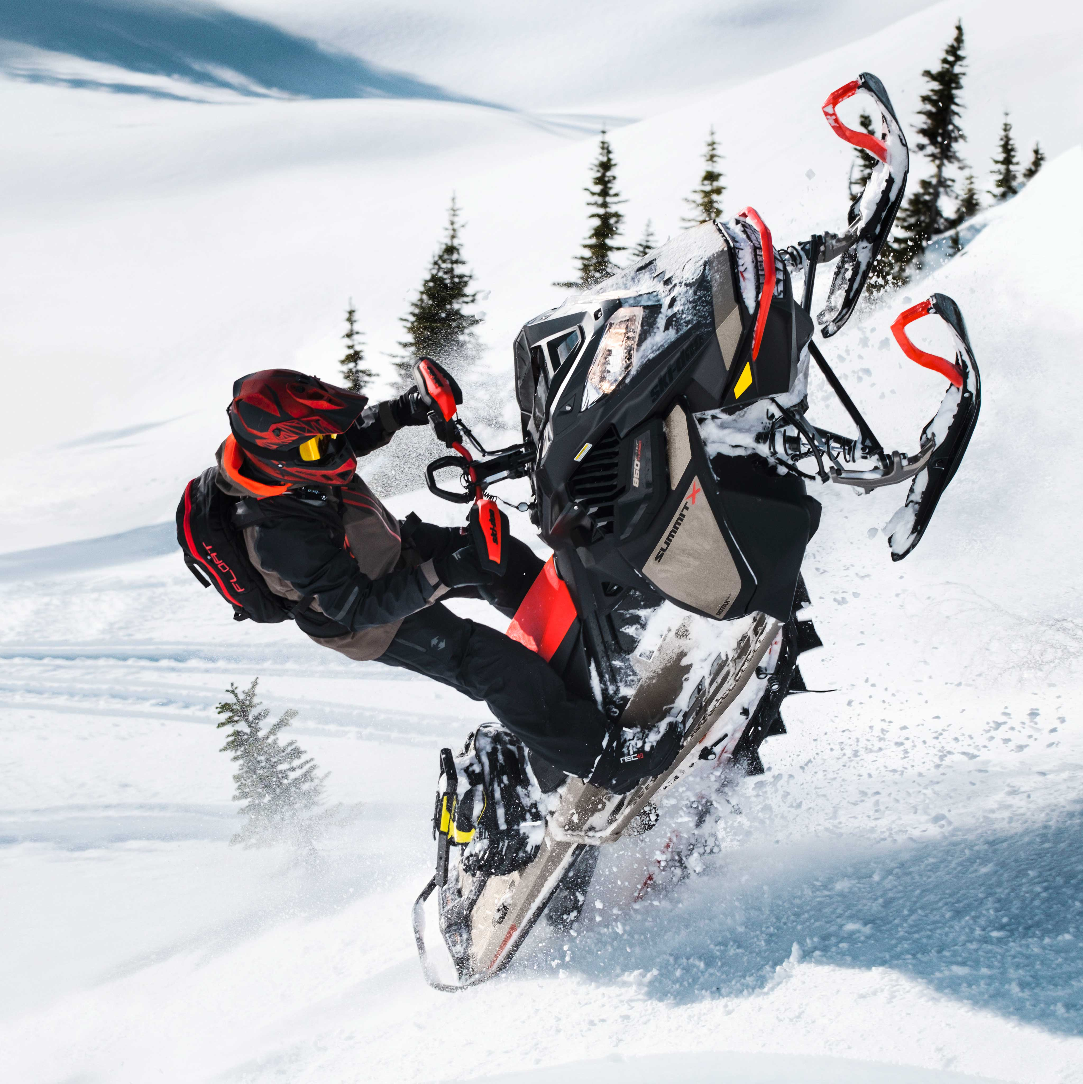 Man riding a Ski-Doo Summit with accessories