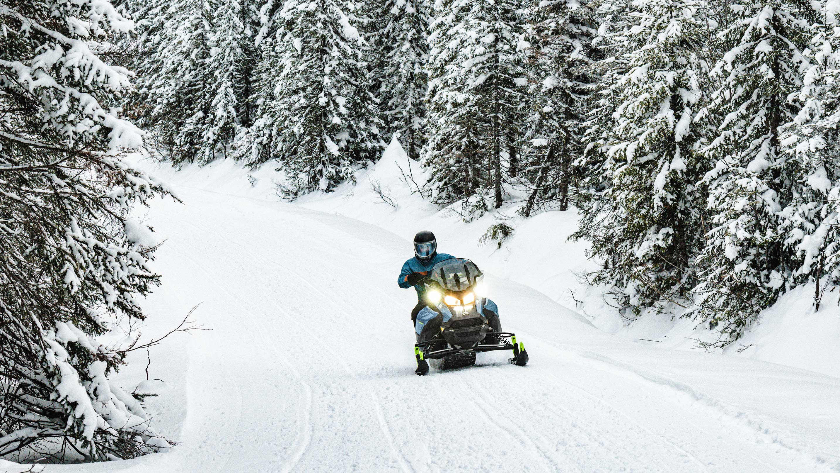 Man riding a 2022 Ski-Doo Renegade on a trail