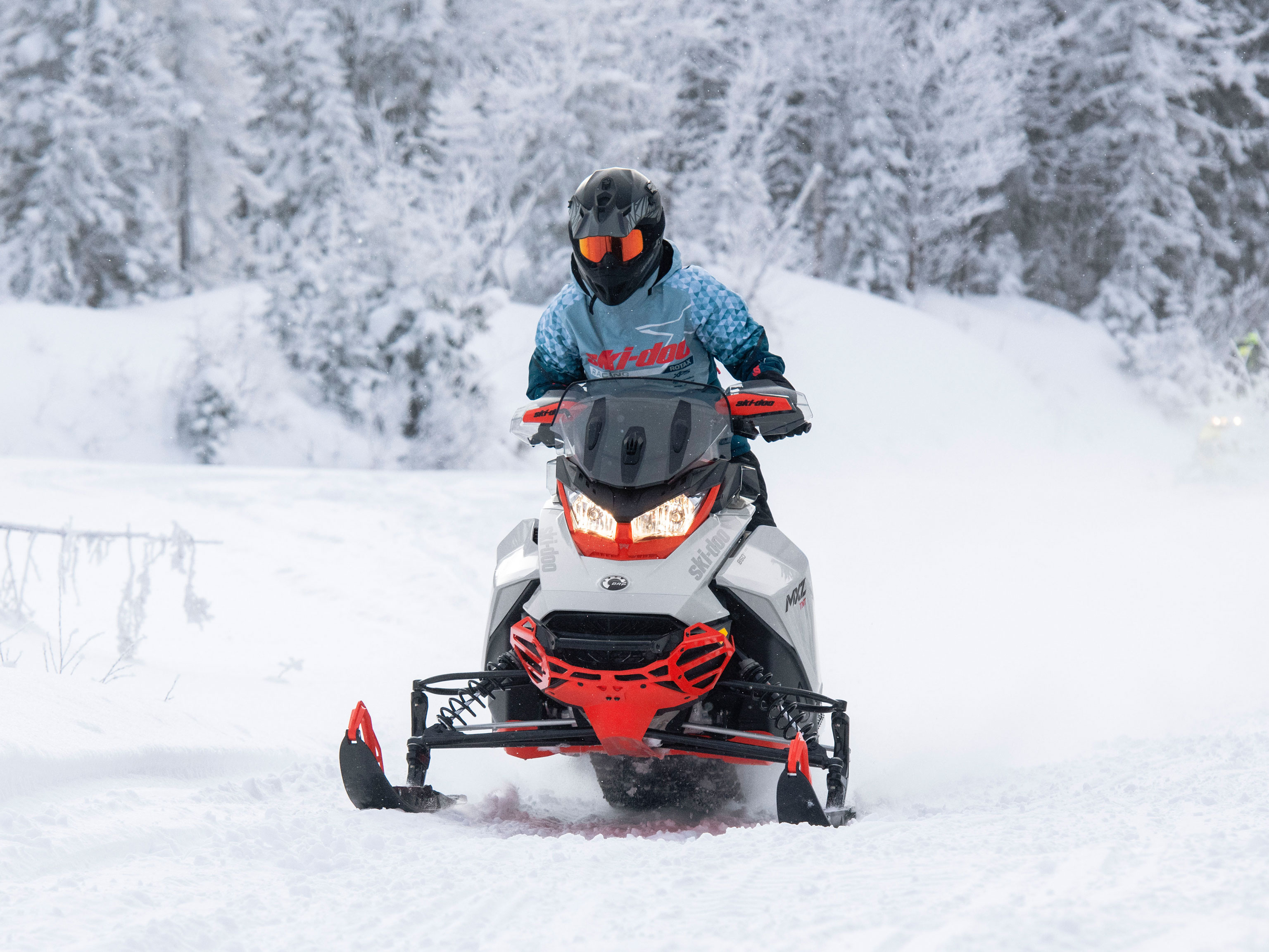 2022 Ski-Doo MXZ on a snowmobile trail