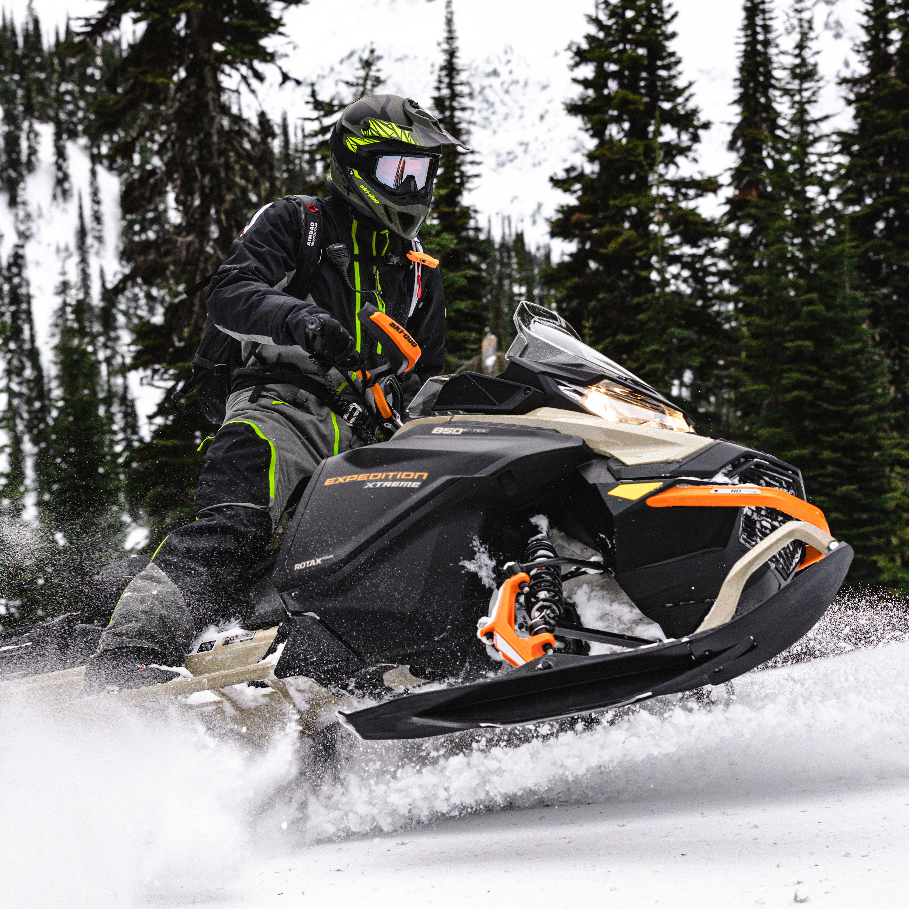 Rider driving his Ski-Doo Expedition, utility snowmobile