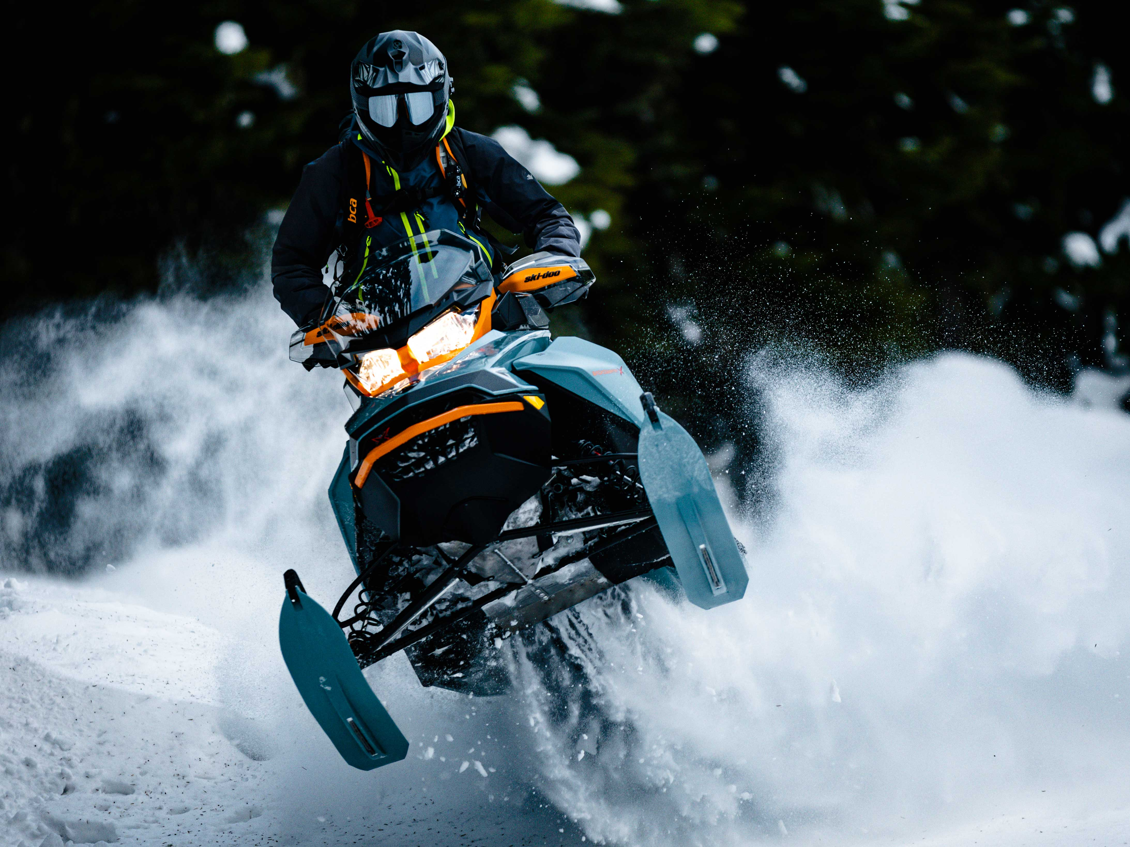Man jumping in Powder with a 2022 Ski-Doo Backcountry