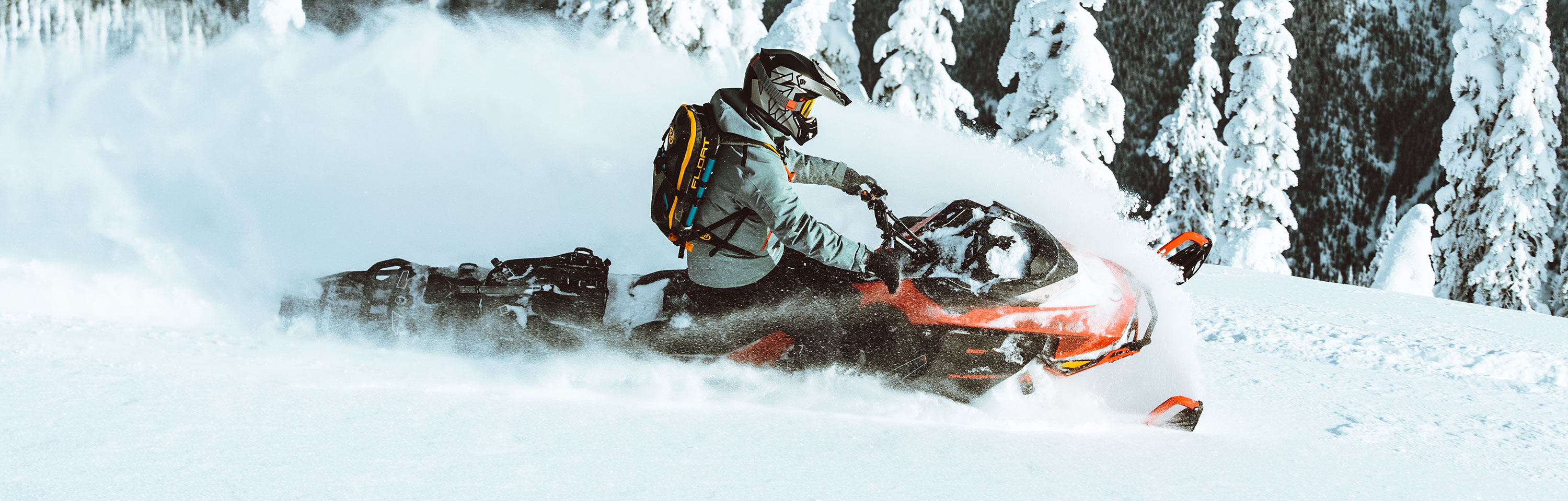 Man riding a snowmobile with High Tech Snowmobile Riding Gear