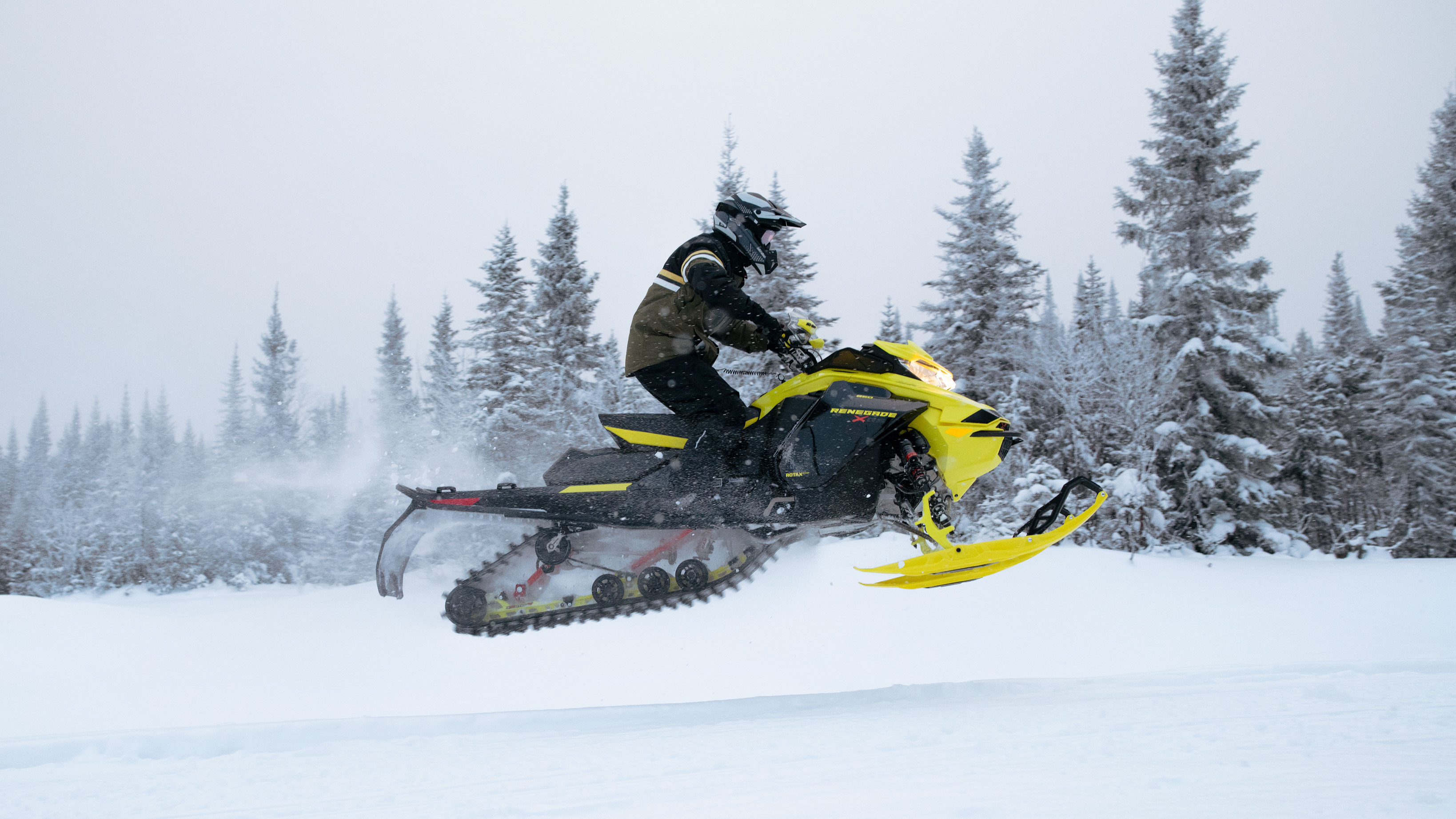 Man jumping with his Ski-Doo Renegade on a trail
