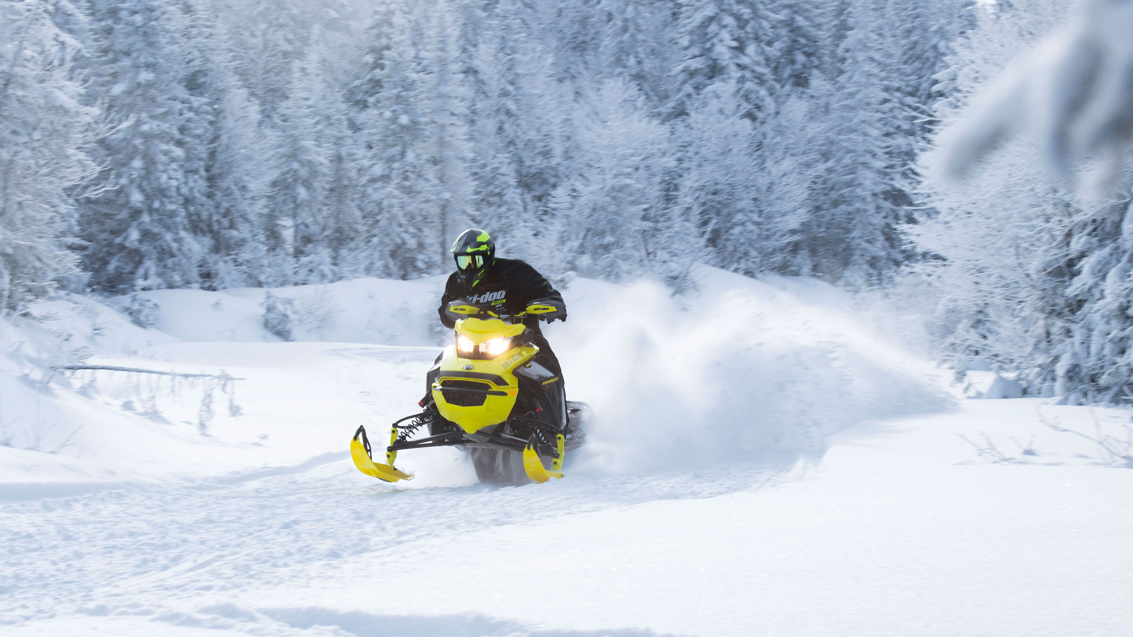 Man riding the new Ski-Doo Renegade on a trail