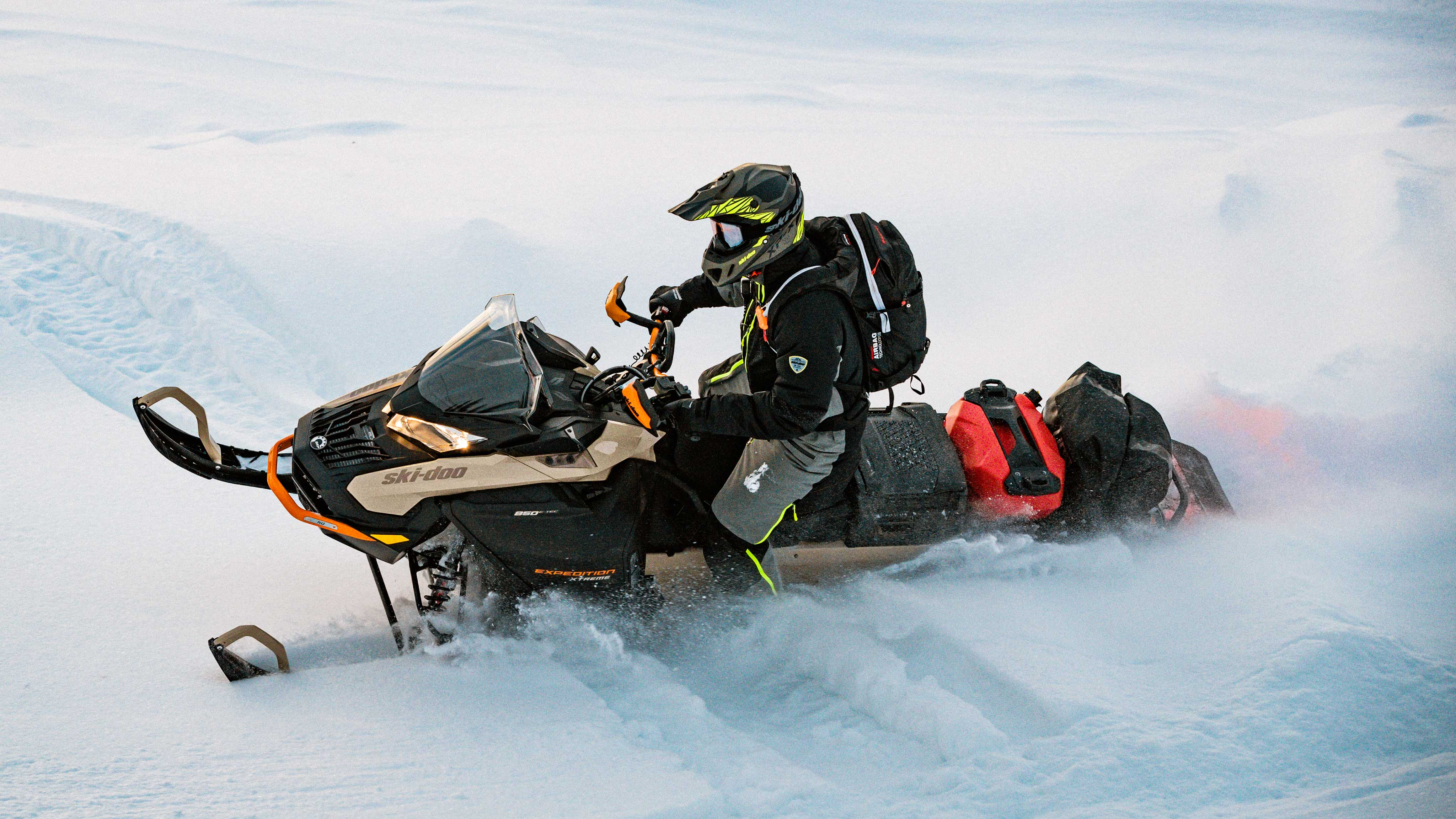 Man driving Ski-Doo Expedition in deep snow