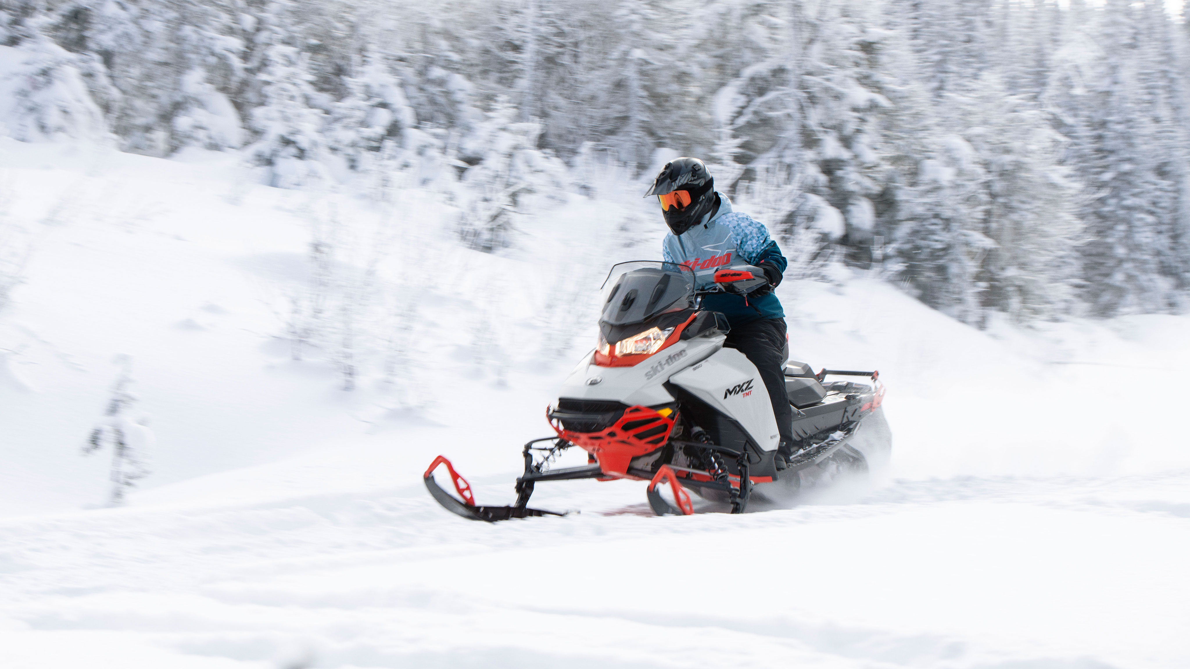 Man riding the new Ski-Doo MXZ on a trail