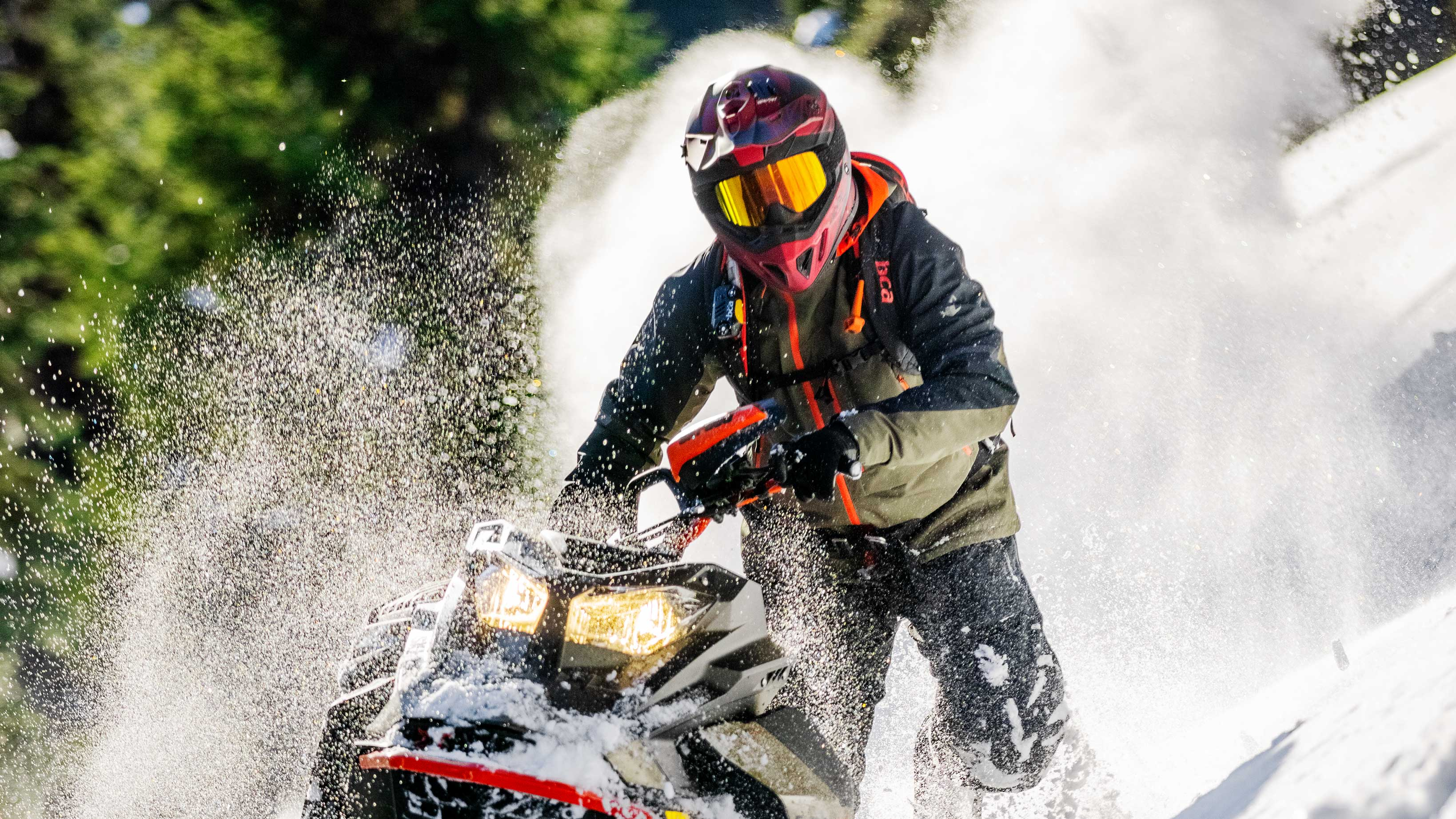 Man riding Powder with his 2022 Ski-Doo Summit