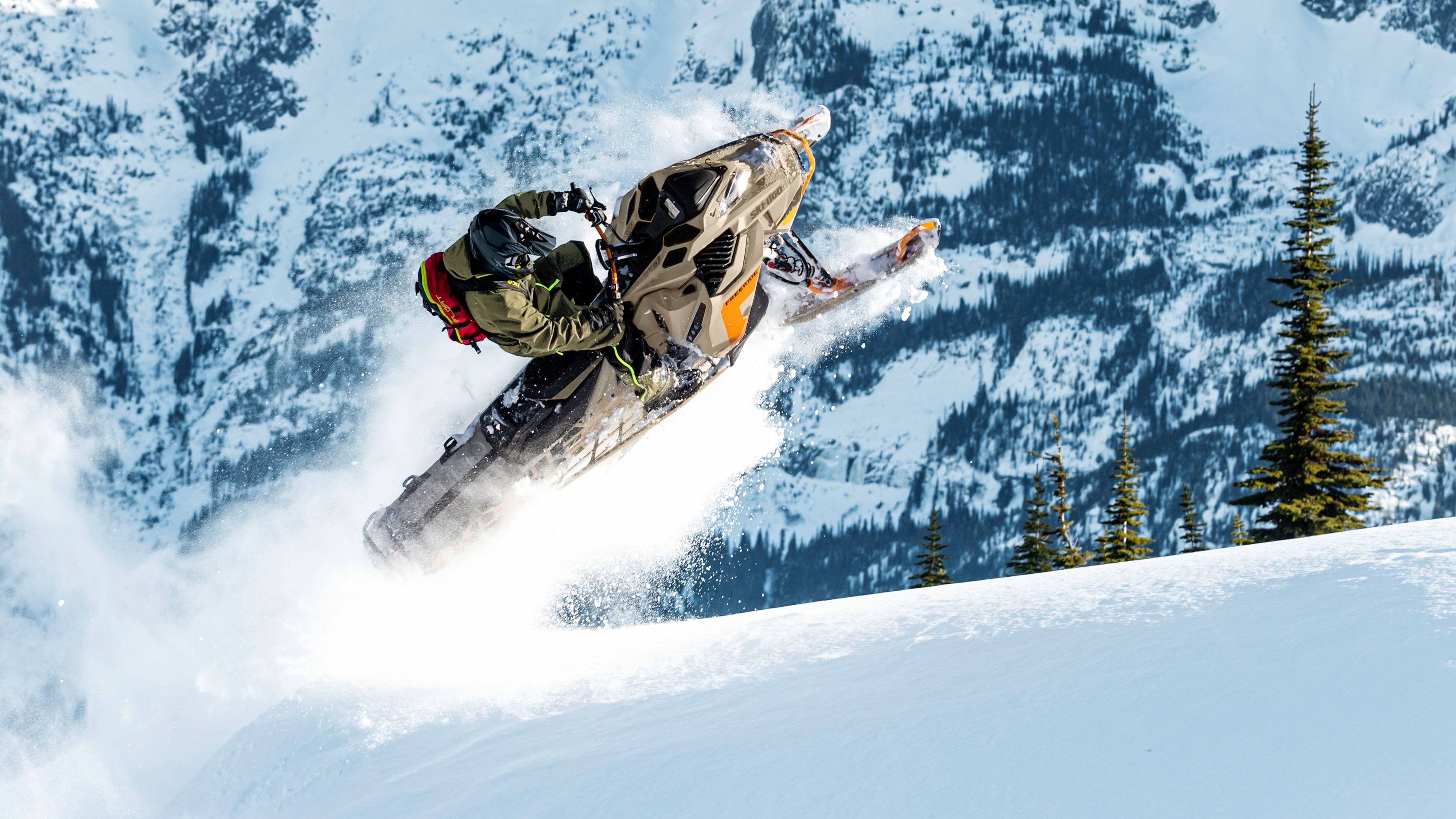 Rider jumping in deep powder with Ski-Doo Freeride