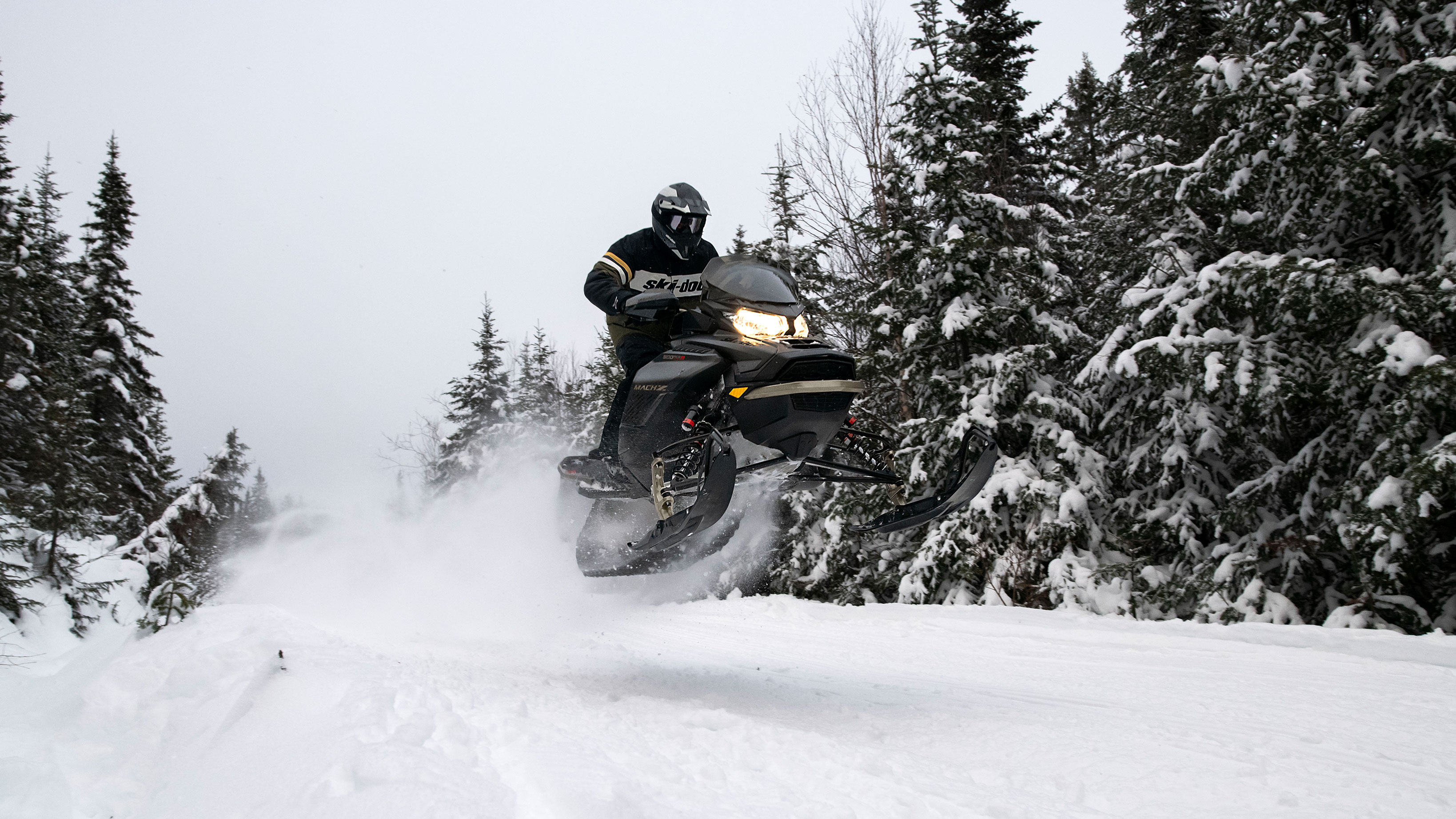 Man jumping with his Ski-Doo Mach-Z on a trail