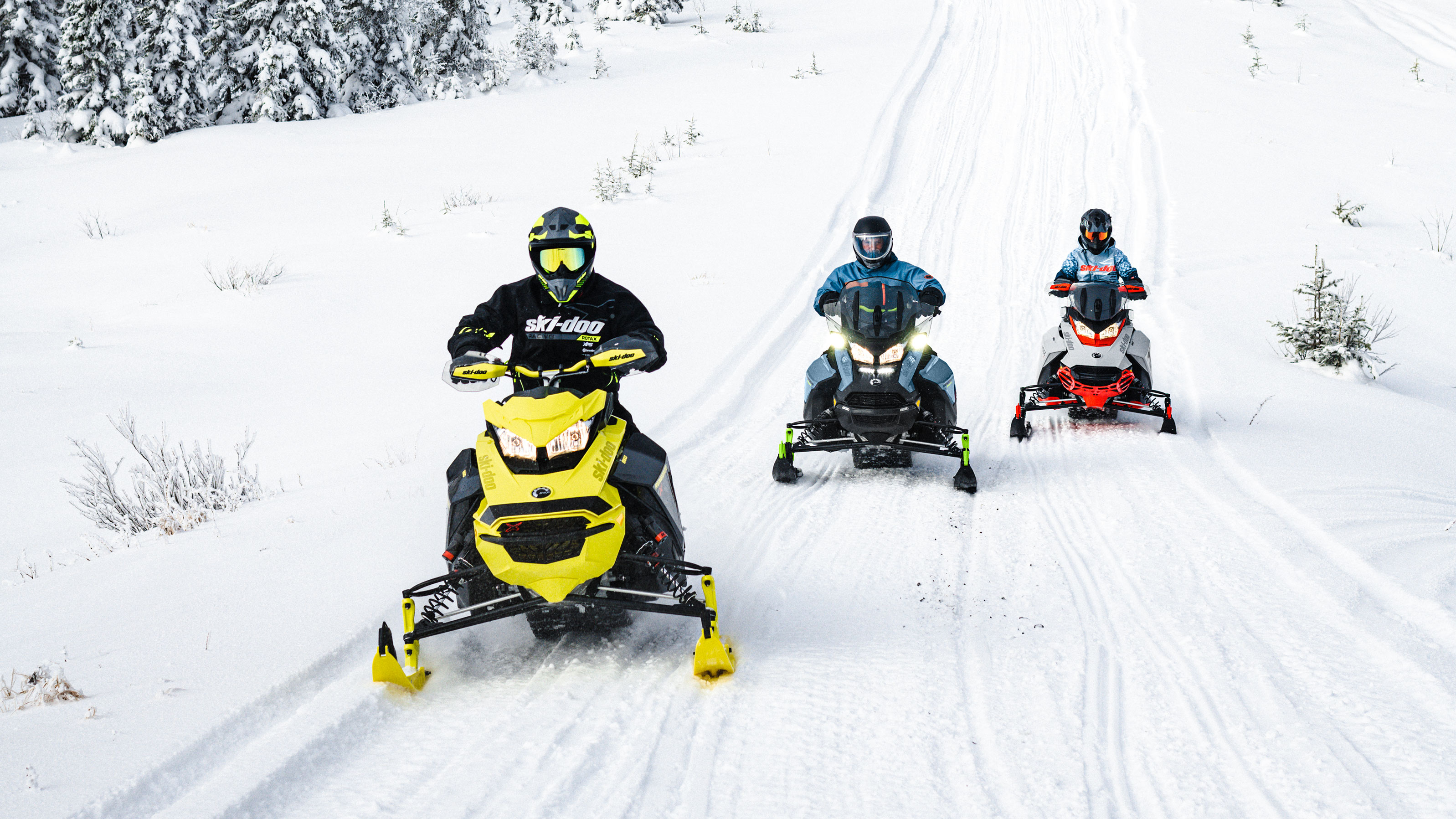 3 riders snowmobiling on a snow trail with their 2022 SKi-Doo