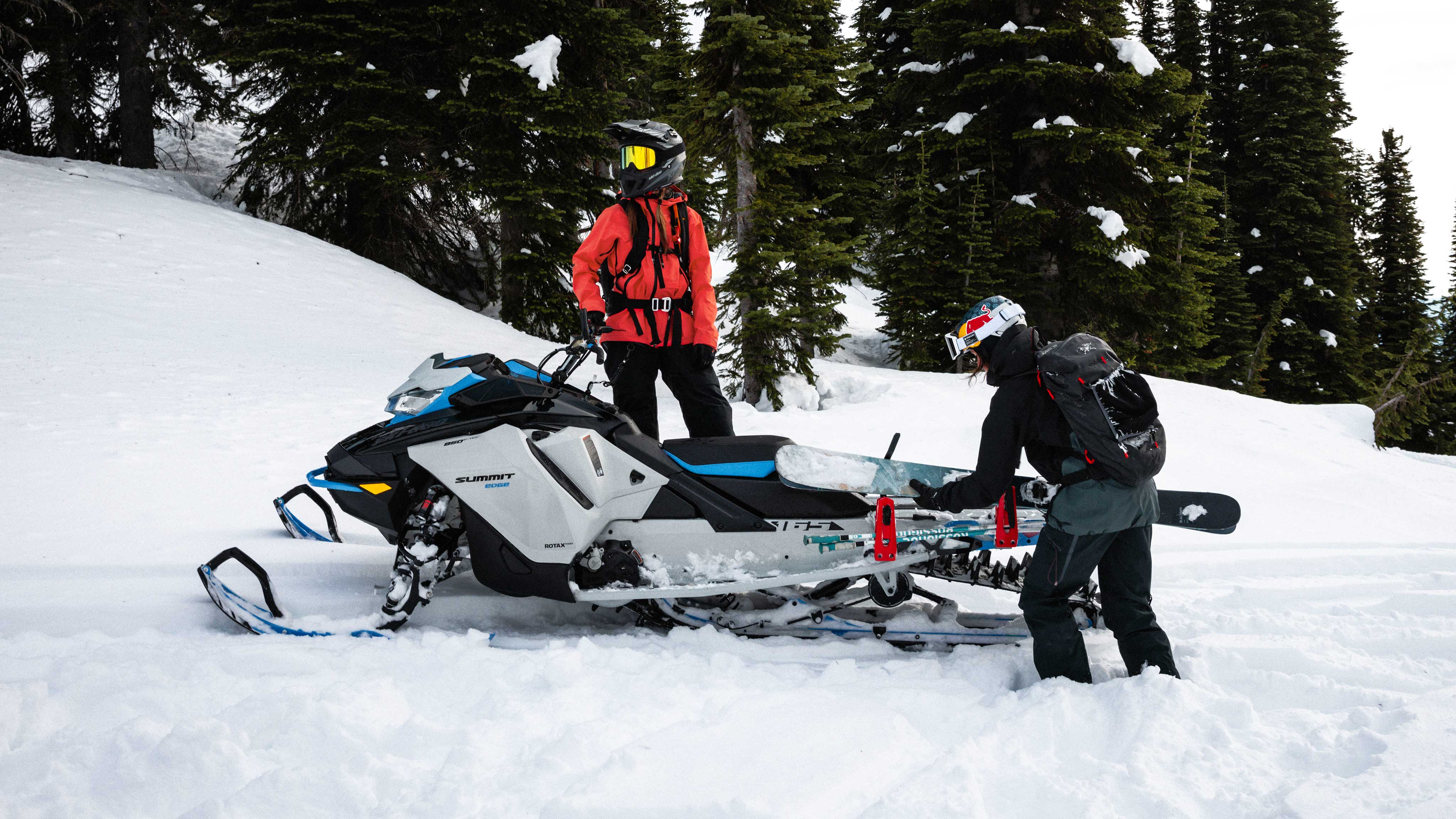 2 riders prepraring a Sled skiing session with a Ski-Doo Summit