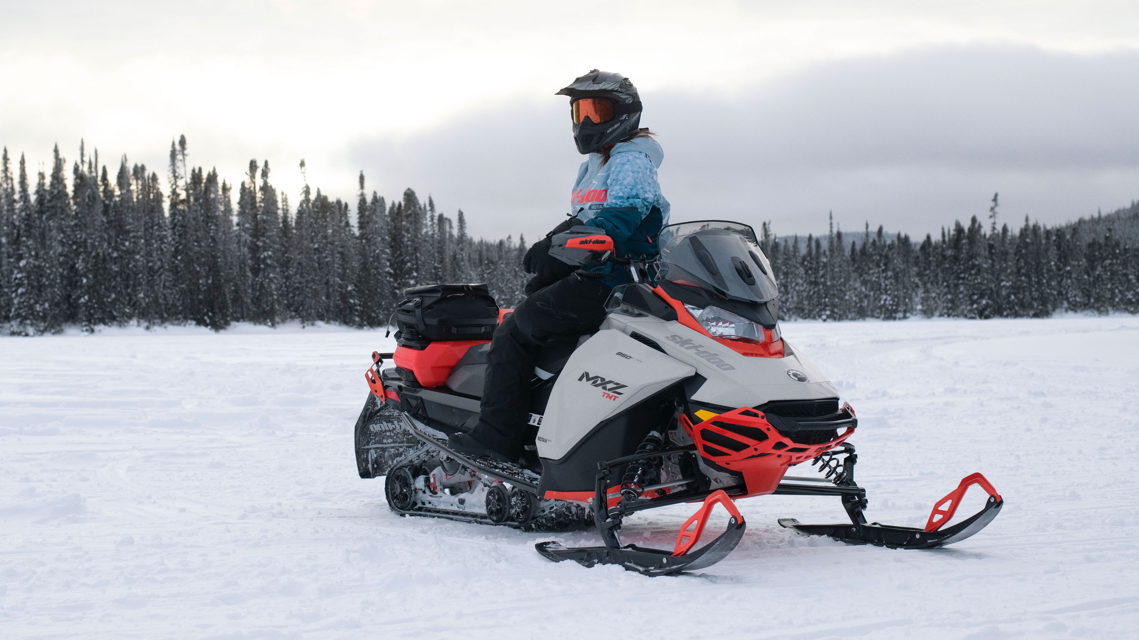 Woman sitting on her 2022 Ski-Doo MXZ