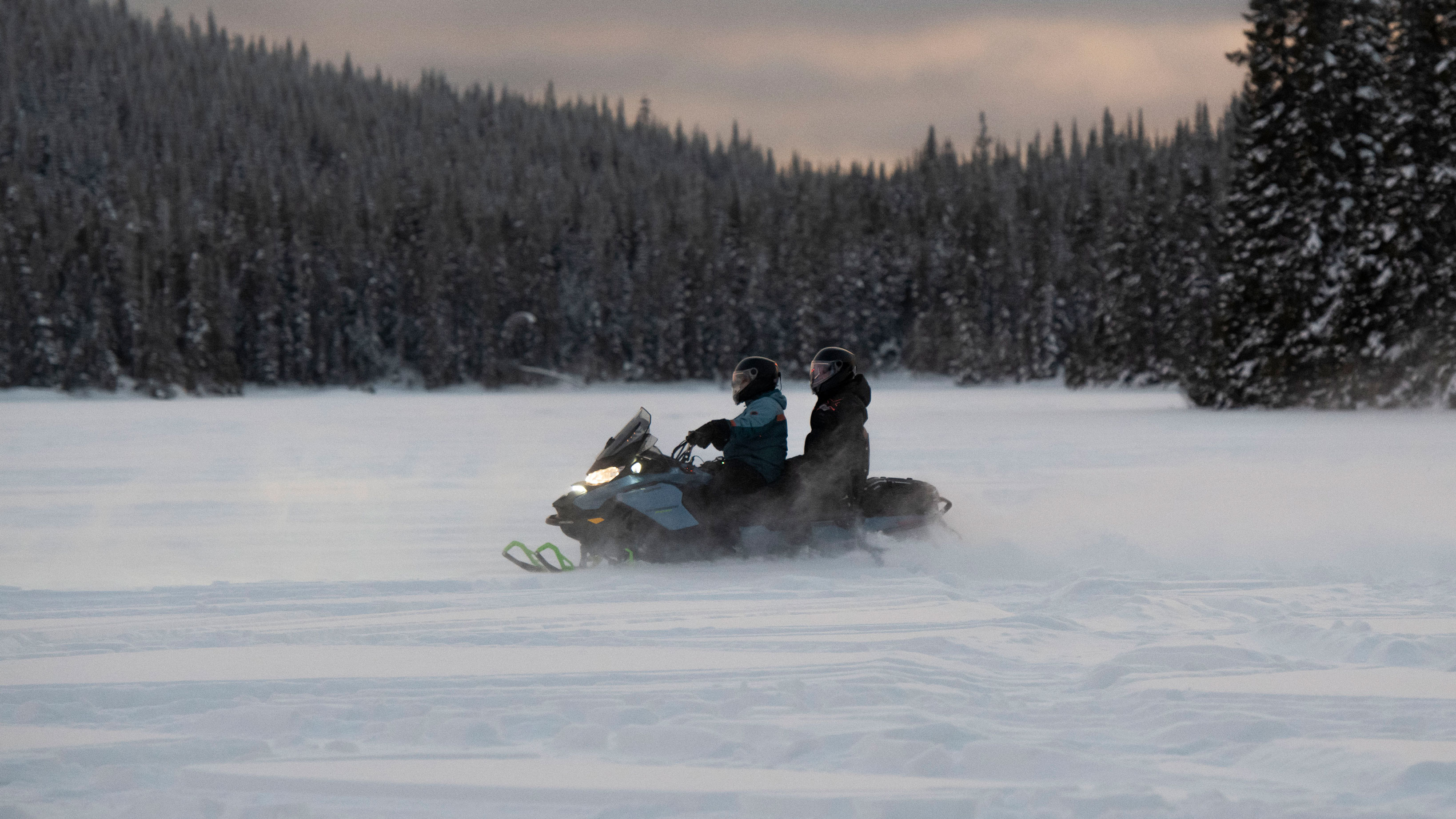 Couple riding their 2022 Ski-Doo Renegade